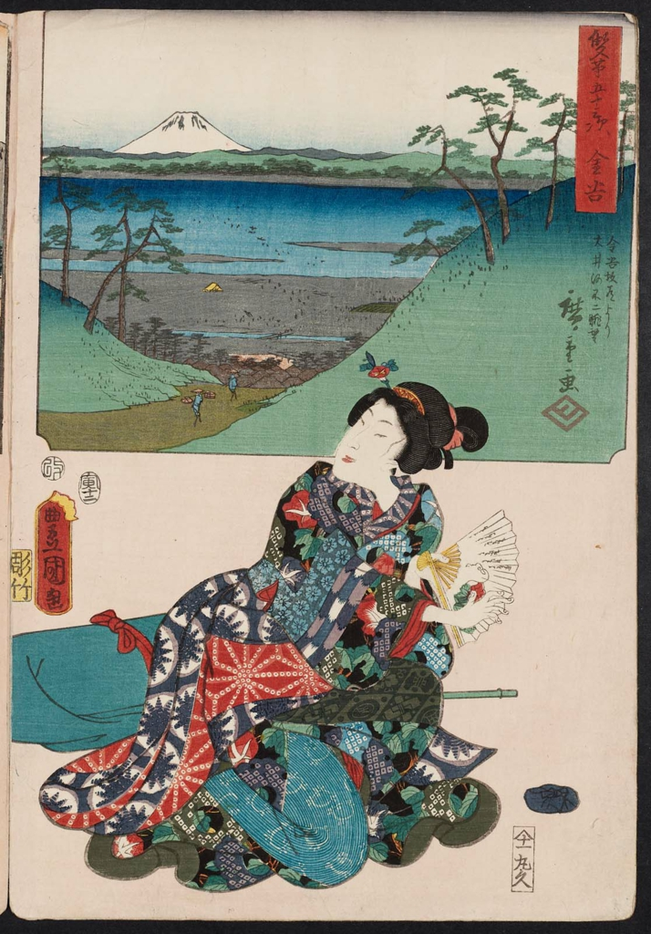 A painting of a woman in traditional Japanese dress. She kneels on the floor and holds a fan. Behind her is a box out of a pastoral scene: two labourers carrying goods walk a path between two hills from the sea.