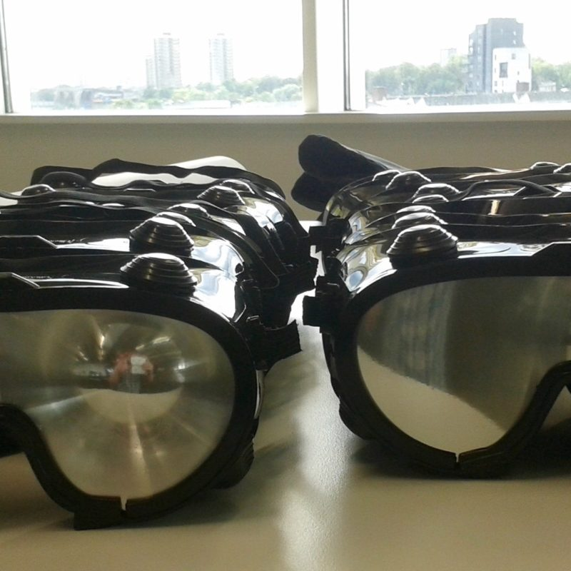 rows of goggles with mirrored lenses on a table