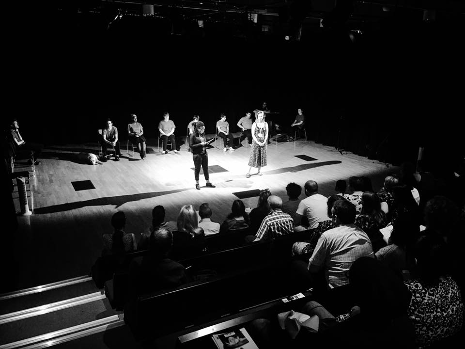 Black and white photo of participants on stage at mac Birmingham for the final sharing