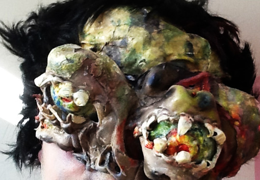 Closeup of Zombie with horrific eyes bulging out of their sockets