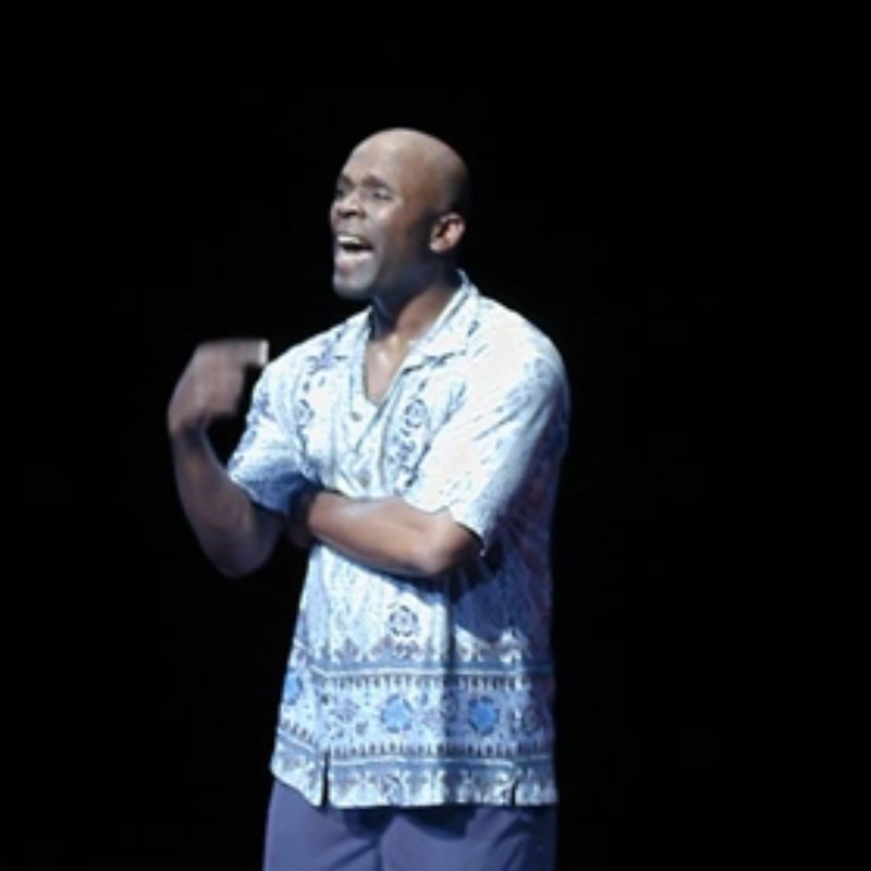 African American male performer - only his figure can be seen in the darkness. Film about a touring production