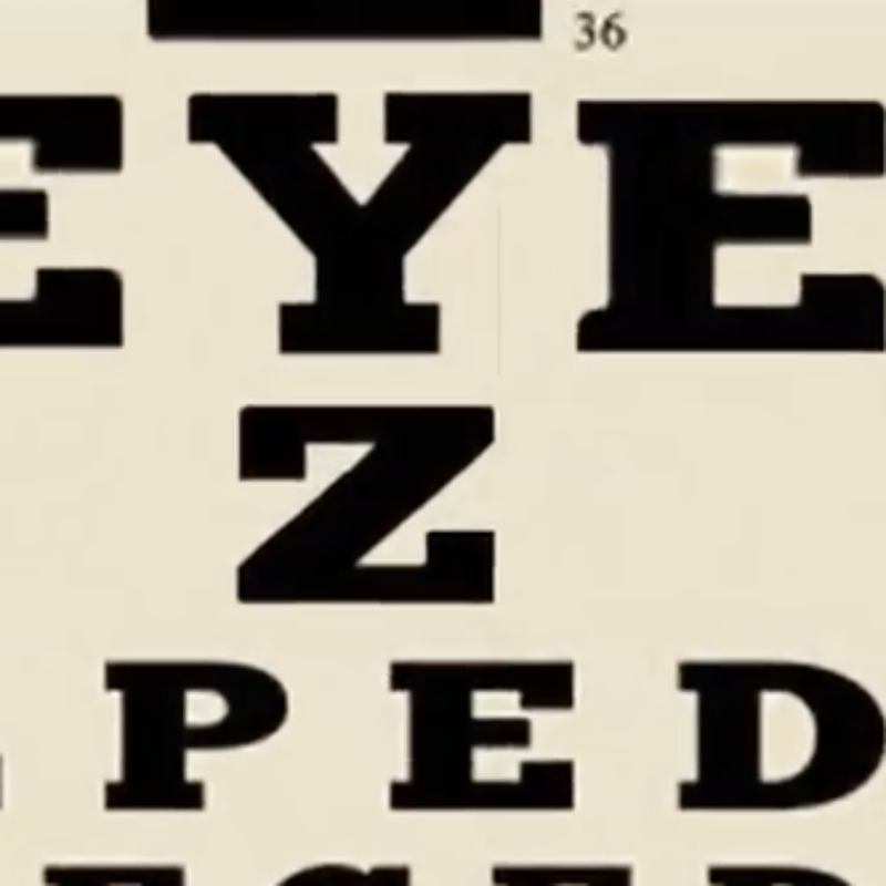 Image still from the trailer video showing an eye chart - amongst the letters