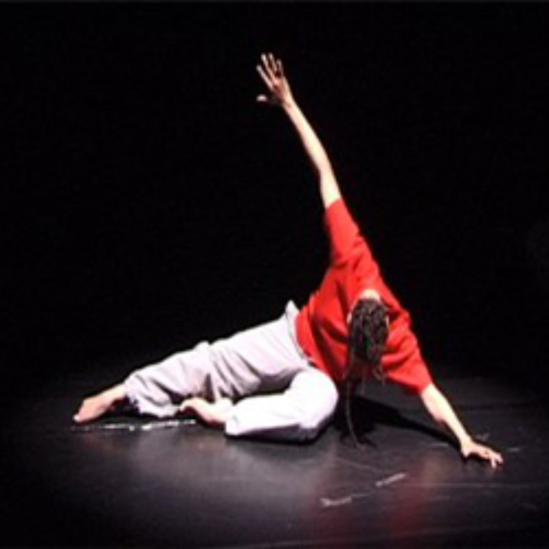 A dancer stretches on the floor