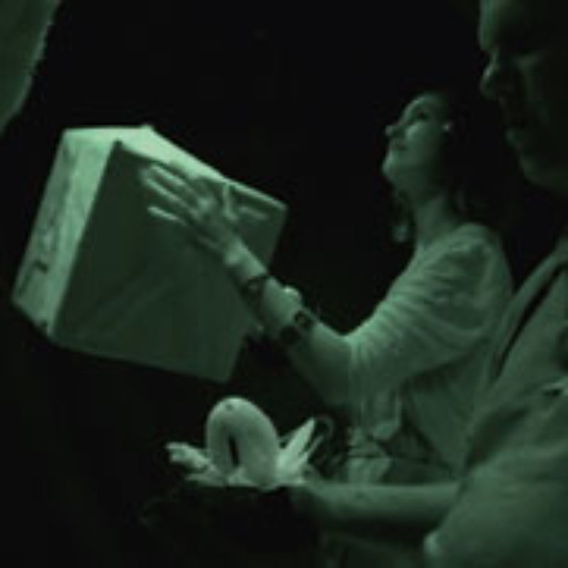 Photo from 'The Question' using a night-vision camera showing a participant holding a box