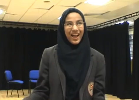 Schoolgirl in hijab being interviewed. Film of a participation project