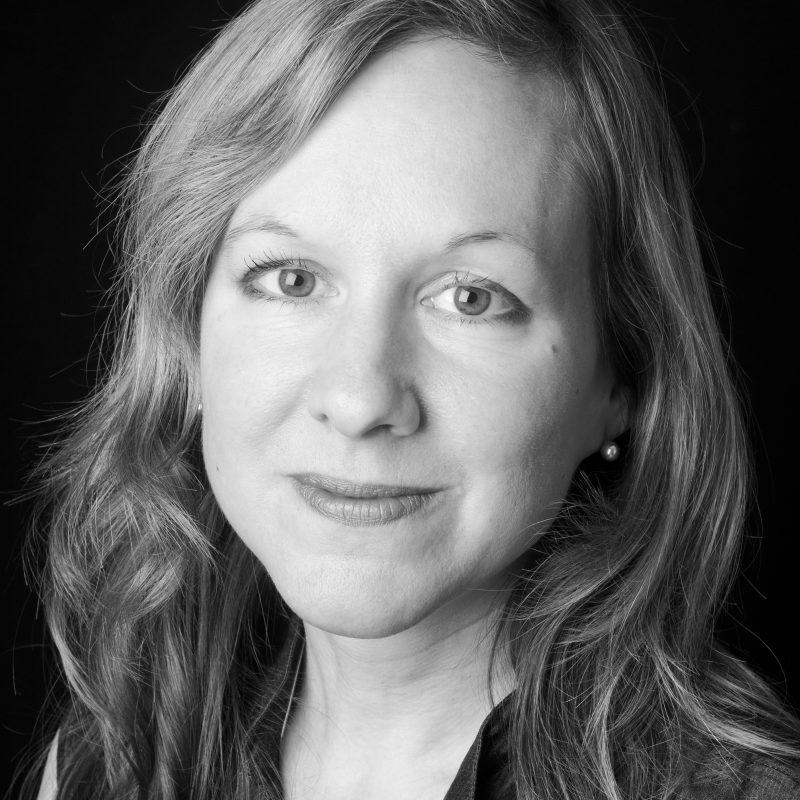 A black and white portrait headshot of Pathways Programme Manager Caroline Joyner.