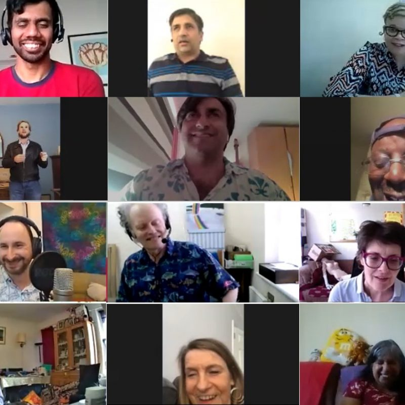 A composite image of twelve screen grabs from a Zoom meeting, in a three by four rectangular grid formation. Each screenshot contains a close-up profile of an individual Eye Say Eye Say Eye Say comedian in their respective homes, smiling towards the camera.