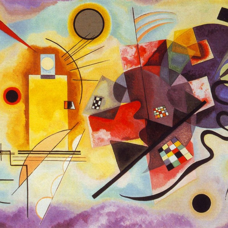 The left of the painting is a blue purple colour and towards the right it is yellow. In the centre red is prominent, in the shape of a cross. These three background colours all melt together so there are no edges. A variety of squares, circles, triangles and abstract shapes are dotted around and overlapped. There are also straight and curved black lines that go through the colours and shapes.
